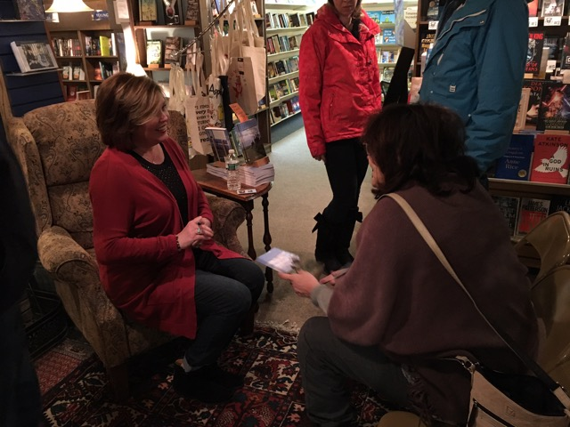 Author Kelle Sutliff Signing Book for Fan